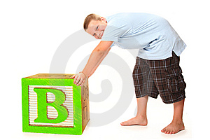 Boy With Giant Block Stock Images - Image: 14649994