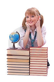 Schoolgirl With The Stack Of Book And Globe Stock Photography - Image: 14650302
