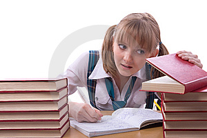 Schoolgirl Is Watching Furtively Textbook. Royalty Free Stock Images - Image: 14650309