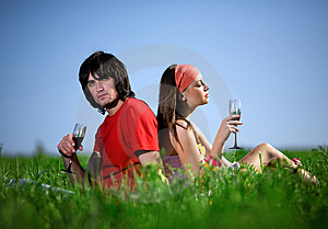 Girl In Kerchief And Boy With Wineglasses On Grass Royalty Free Stock Images - Image: 14655589