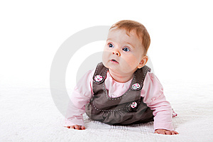 Baby Girl Crawling On The Floor Stock Image - Image: 14678591