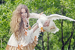 Girl Has Caught A Goose Royalty Free Stock Photos - Image: 14687988