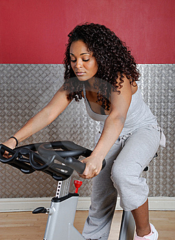 Woman Fitness Trainer On Bicycle Royalty Free Stock Photos - Image: 14694528
