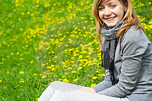 The Girl Sits On A Grass Royalty Free Stock Photos - Image: 14696658