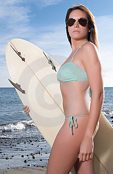 Woman With Sun Glasses And Surfboard Royalty Free Stock Image - Image: 14711946