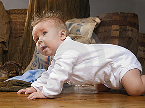 Baby Crawling On A  Floor Royalty Free Stock Photography - Image: 14715677