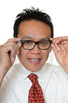Businessman Tests Eyeglasses Royalty Free Stock Image - Image: 14720056