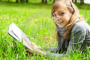 The Girl Reads The Book Stock Photo - Image: 14720240