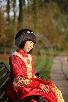 Asian Girl Sitting On Bench Stock Photo - Image: 14720970