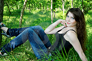 Pretty Woman Lay In Green Grass Royalty Free Stock Photos - Image: 14728658