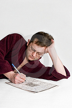 The Man In A Dressing Gown With A Crossword Puzzle Royalty Free Stock Photos - Image: 14742608
