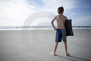 Young Boy At The Beach Royalty Free Stock Image - Image: 14746996