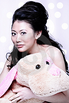 Asian Girl Holding Stuff Animal Royalty Free Stock Image - Image: 14748336
