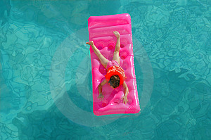 The Little Girl Floats On An Inflatable Mattress Stock Images - Image: 14752174