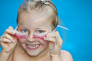 Young Pretty Girl In Swimming-pool Holding Googles Royalty Free Stock Photo - Image: 14755165