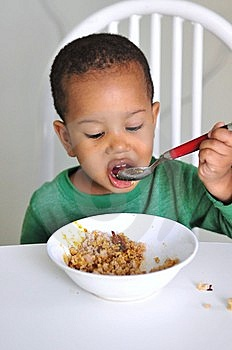 Child Eating At Table Royalty Free Stock Photography - Image: 14776417