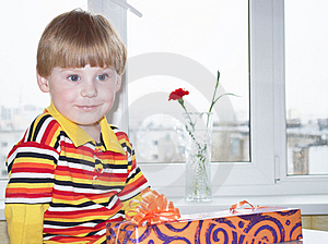 The Boy With A Gift Stock Image - Image: 14776571