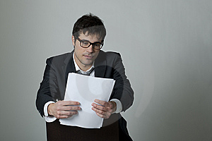 Businessman Reading Document Stock Images - Image: 14777624