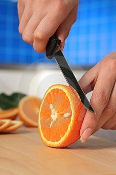 Female Chopping Juicy Orange. Royalty Free Stock Image - Image: 14796696
