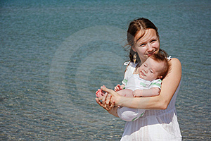 Mother And Baby On Sea Background Stock Photos - Image: 14798643