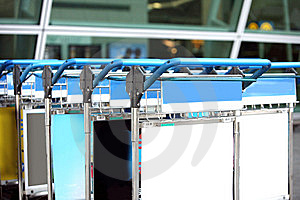 Luggage Carts At Busy Airport Royalty Free Stock Photos - Image: 14803828