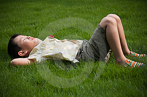 Sleeping On The Grass Boy Stock Photography - Image: 14808872