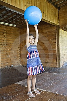 Little Girl Holding Up Ball Royalty Free Stock Images - Image: 14811379