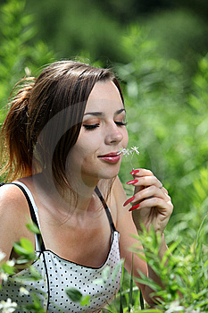 Girl Smell A Flower Royalty Free Stock Photo - Image: 14832605