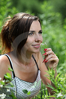 Girl Smell A Flower Stock Image - Image: 14832611