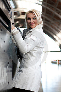 Young Blonde Woman Climbs In A Train Royalty Free Stock Photography - Image: 14832907