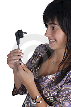 Woman Looking At The Power Plug Stock Photo - Image: 14857820