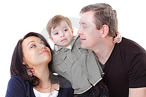 Father And Mother Look At Boy Stock Photography - Image: 14872382