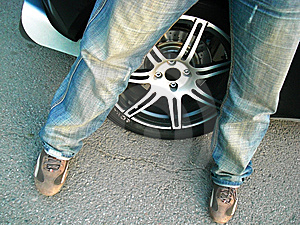The Man Near The Wheel Royalty Free Stock Photography - Image: 14876367