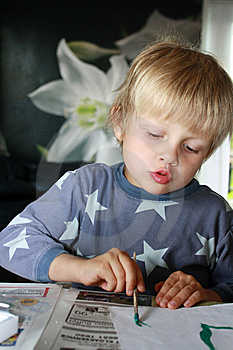 Concentrated Boy Painting Stock Images - Image: 14876944