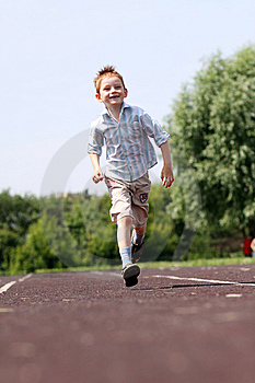 Boy Runs In A Summer Park Royalty Free Stock Photo - Image: 14878345