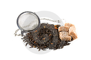 Tea-stainer With Tea And Brown Sugar Stock Images - Image: 14878704
