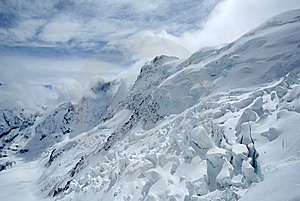 Snow Mountains In Cloudy Weather Stock Images - Image: 14879424