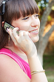 Glad Girl With A Cell Royalty Free Stock Photography - Image: 14889907