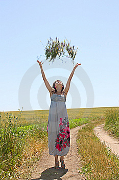The Girl Throws Upwards A Bunch Of Flowers Stock Photos - Image: 14892643