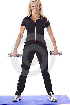 Woman Lifting Weights On Floor Mat Stock Photos - Image: 14897023