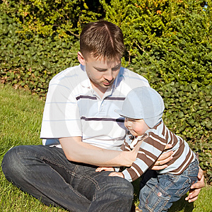 Father And Son On The Grass Stock Photo - Image: 14898780