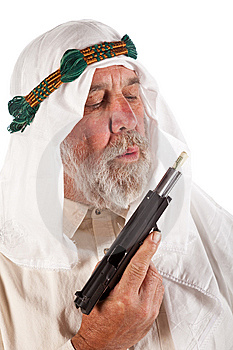 Arab Man Blowing On Money Stuffed In A Gun Royalty Free Stock Photo - Image: 14923615