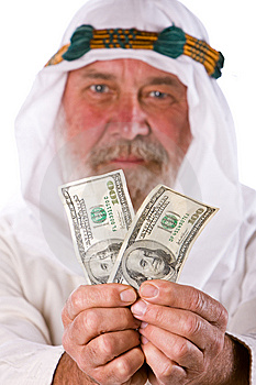Senior Arab  Man Offering Money Stock Image - Image: 14924081