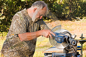 Senior Man Cutting Wood Royalty Free Stock Photo - Image: 14924115