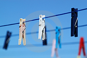 Cloth Pegs With A Under The Blue Sky Stock Photo - Image: 14926670