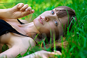 Portrait Of The Young Girl On A Lawn. Stock Images - Image: 14939394