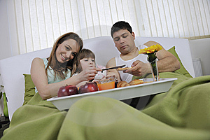 Happy Young Family Eat Breakfast In Bed Royalty Free Stock Photo - Image: 14944345