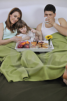 Happy Young Family Eat Breakfast In Bed Royalty Free Stock Photography - Image: 14944467