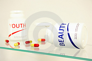 Beauty And Youth Pills In A Bottle Royalty Free Stock Images - Image: 14944939