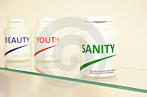 Sanity, Beauty And Youth Pills In A Bottle Royalty Free Stock Image - Image: 14944966